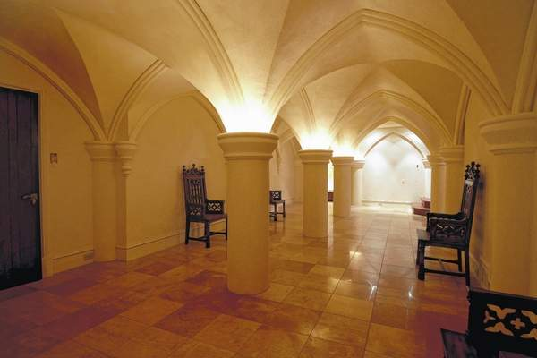 The basement hall of the house. Here, one might imagine monks or nuns processing through chanting on the way to chapel.